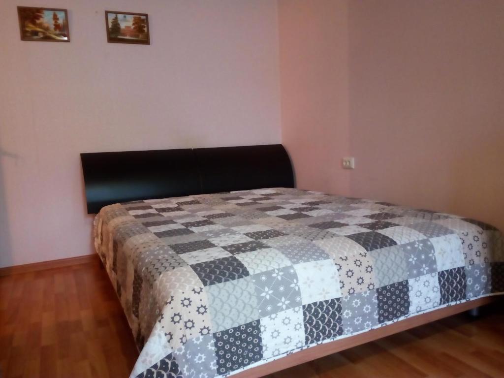 Кровать или кровати в номере Apartament in center