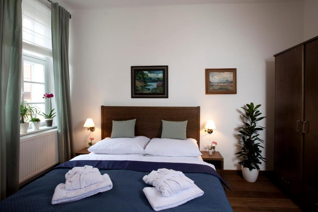 A bed or beds in a room at Apartmány Šupina
