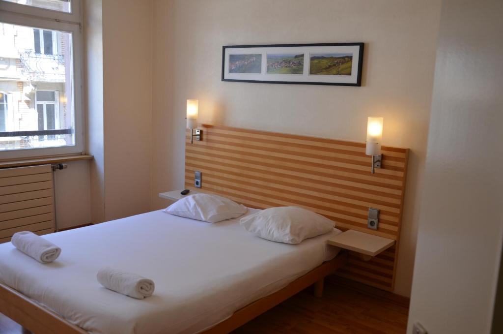 A bed or beds in a room at Cap Europe
