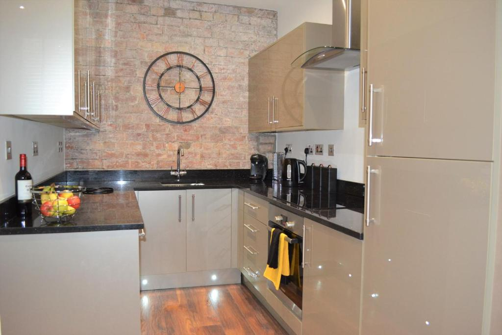 A kitchen or kitchenette at OnPoint Apartments - PERFECT 5-Star Deluxe Apartment City Centre VIP