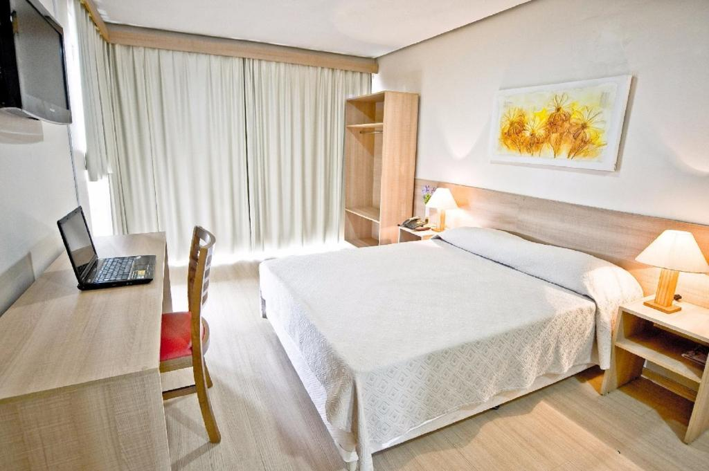A bed or beds in a room at Dan Inn Express Porto Alegre