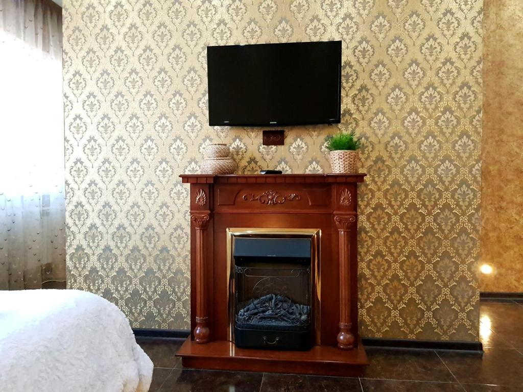 A television and/or entertainment center at Apartment in Cheboksary city center