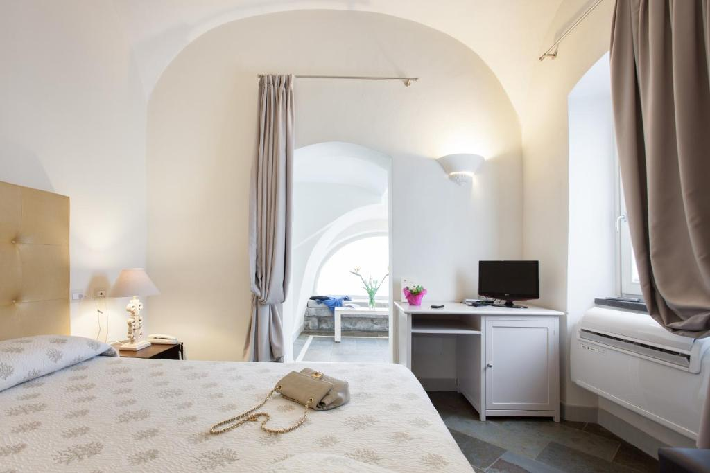 Letto o letti in una camera di Hotel Maison Tresnuraghes
