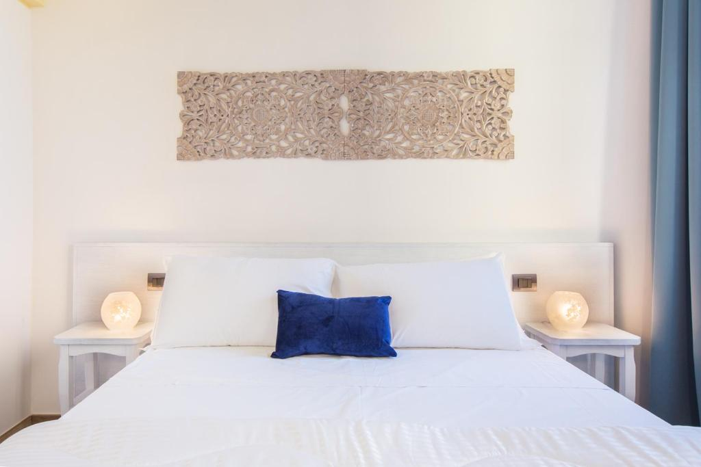 A bed or beds in a room at Residenza le Scalette