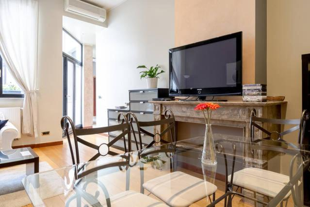 A television and/or entertainment centre at Appartement Grand Place