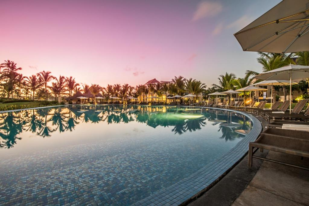 The swimming pool at or close to Hard Rock Hotel & Casino Punta Cana - All Inclusive