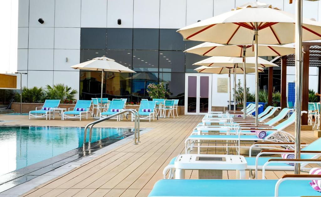 The swimming pool at or near Premier Inn Dubai Ibn Battuta Mall