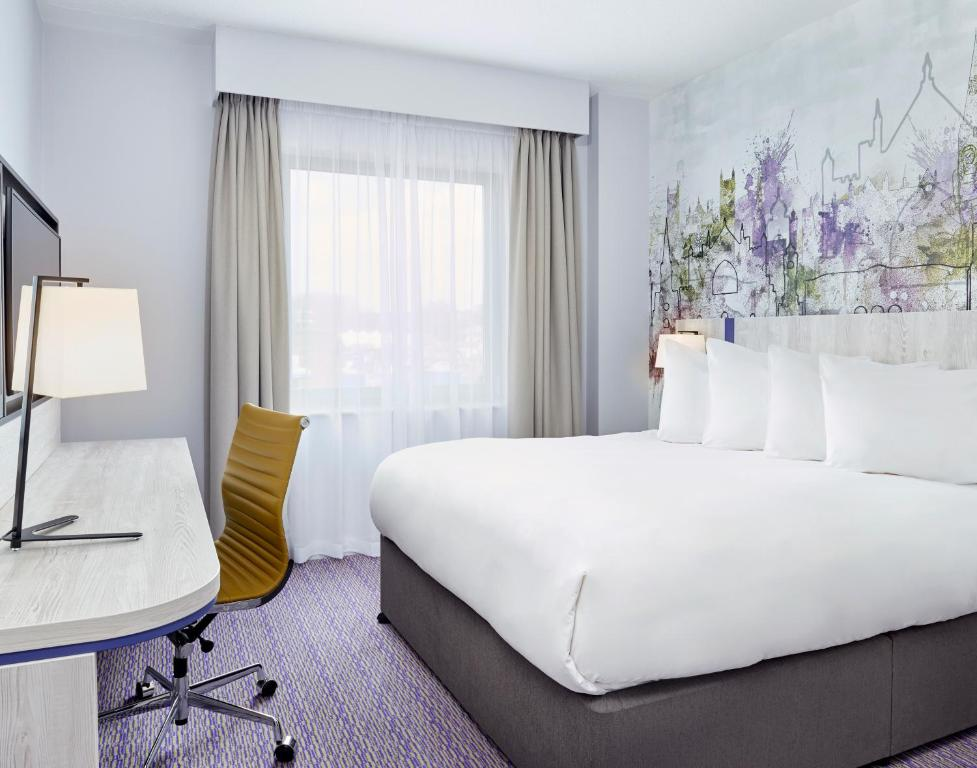 A bed or beds in a room at Jurys Inn Exeter