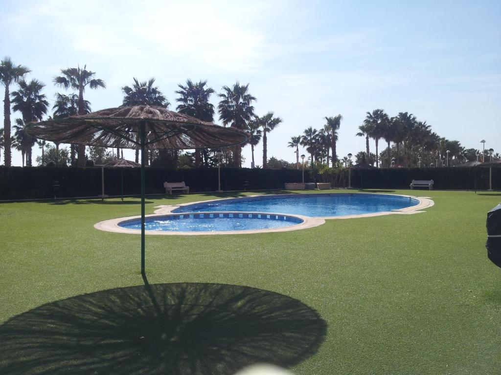 The swimming pool at or close to ACV - Vistamar II-1ª Linea Planta 9 Sur