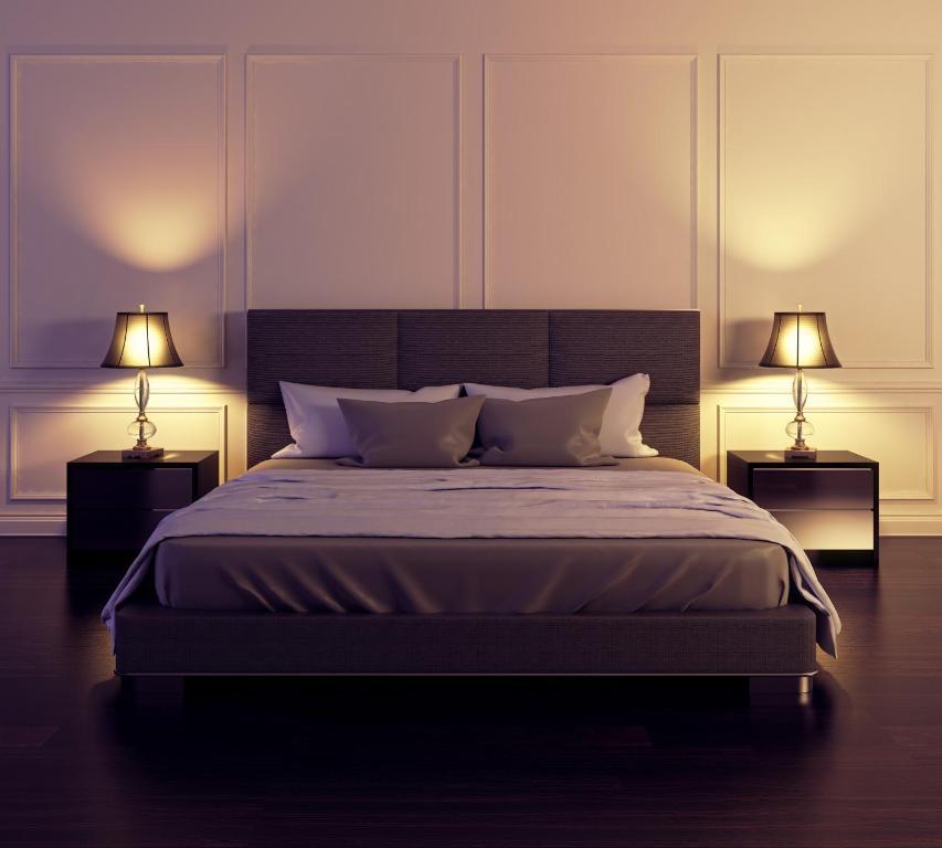 Een bed of bedden in een kamer bij CityApartHotel 7Straatjes