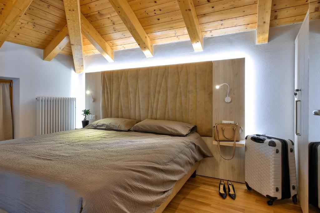 A bed or beds in a room at Concilium