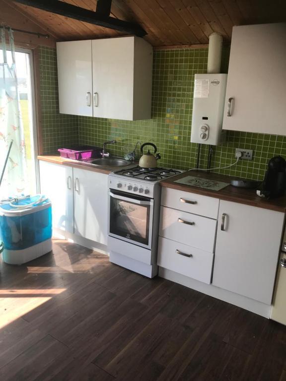 A kitchen or kitchenette at Sheppey villa