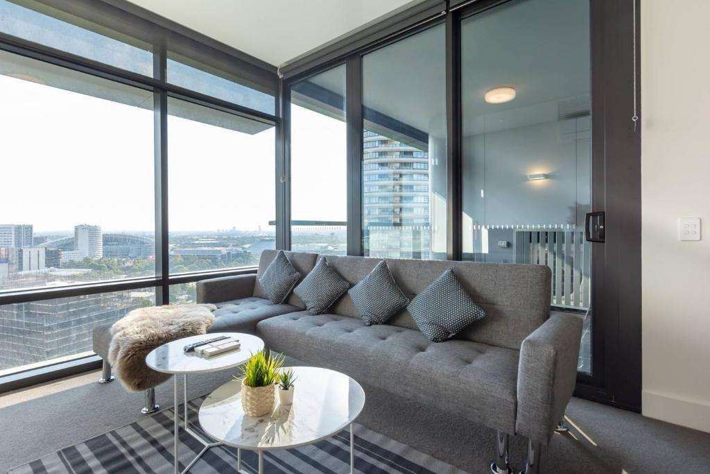 A seating area at Face to ANZ Stadium Two Bedder Apt