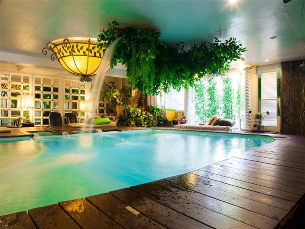 The swimming pool at or near Diamond City Hotel SHA Certified