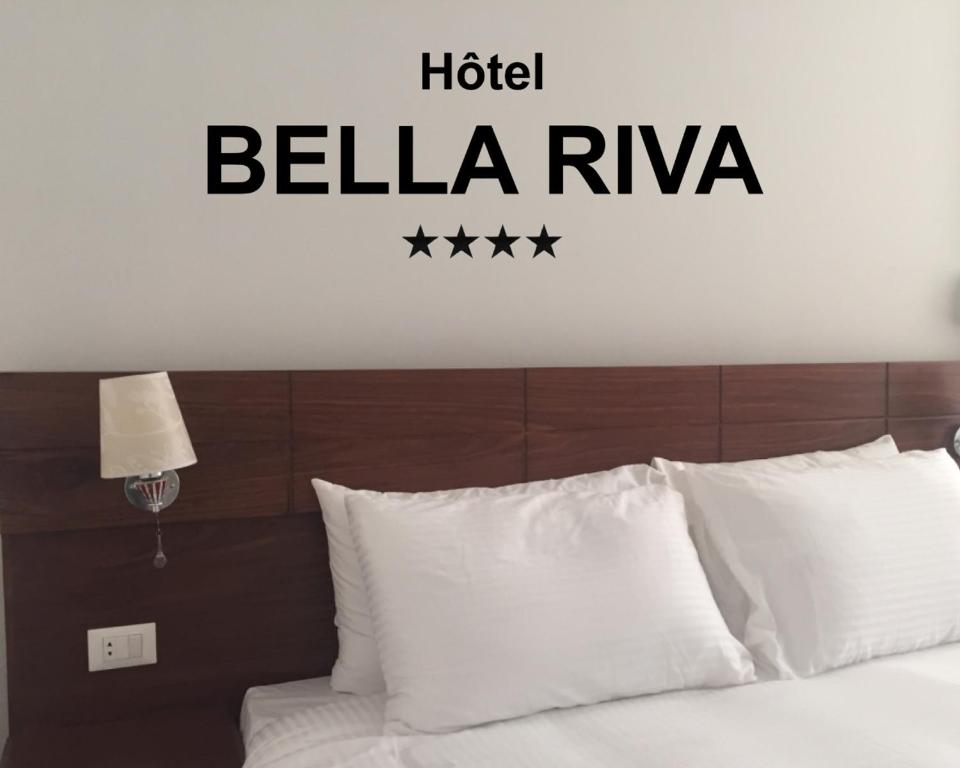 A bed or beds in a room at Hotel Bella Riva Kinshasa