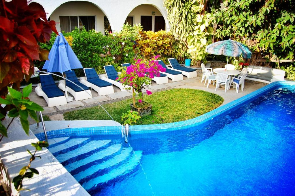 The swimming pool at or near Hotel Delfin