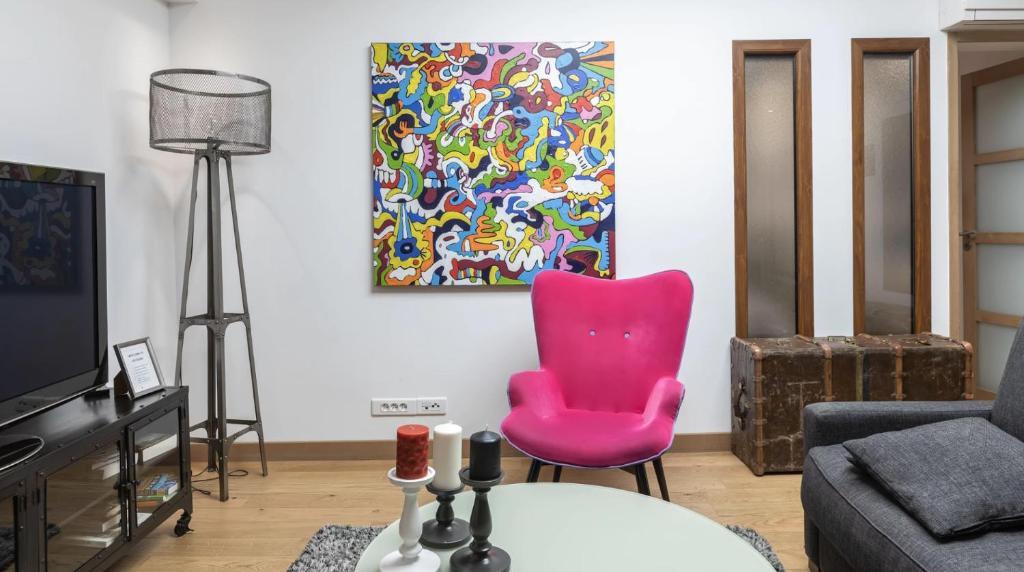 A seating area at 3-bedroom apartment Quai des Grands Augustins