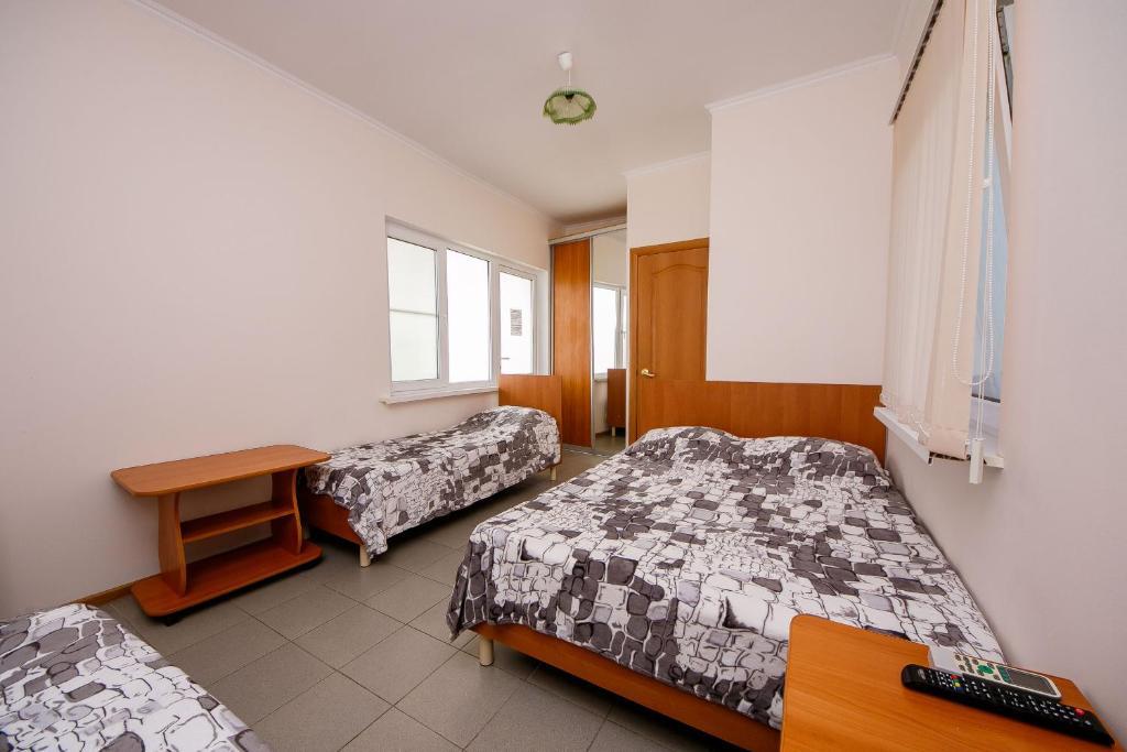 Кровать или кровати в номере Guest House Baden Baden