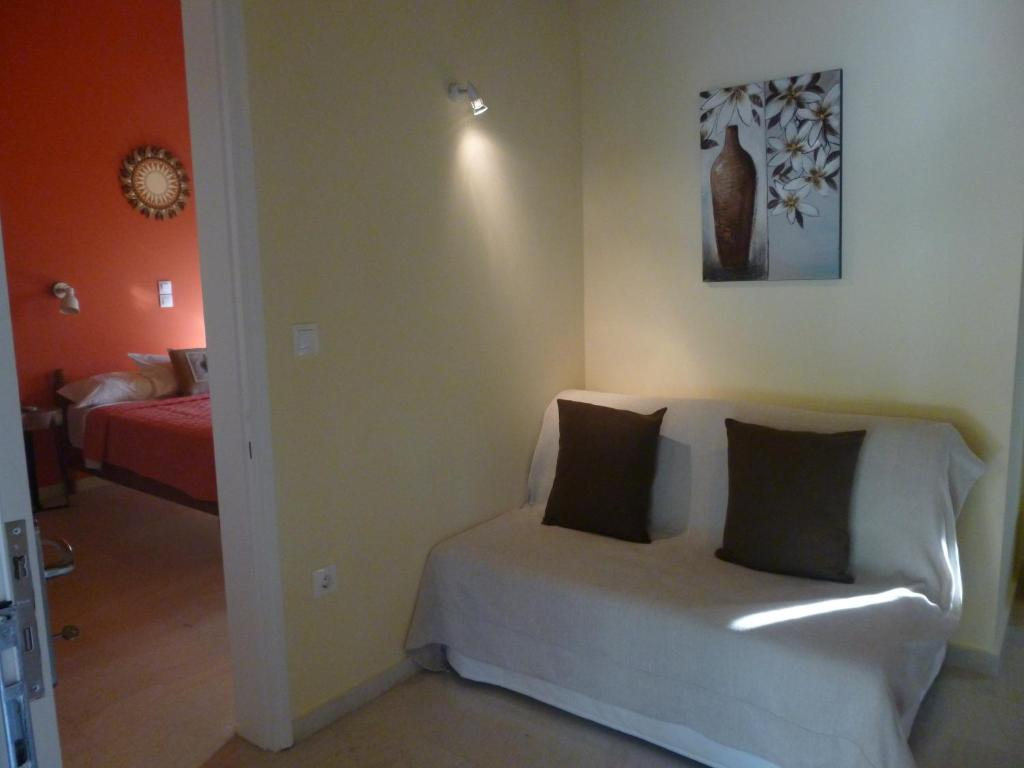 A bed or beds in a room at Athina Apartments