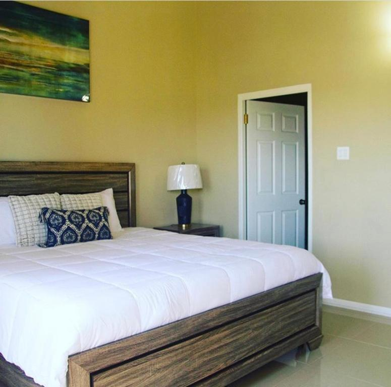 A bed or beds in a room at Comfort Homes Kingston