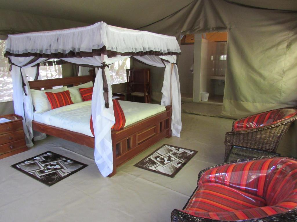 A bunk bed or bunk beds in a room at Enchoro Wildlife Camp