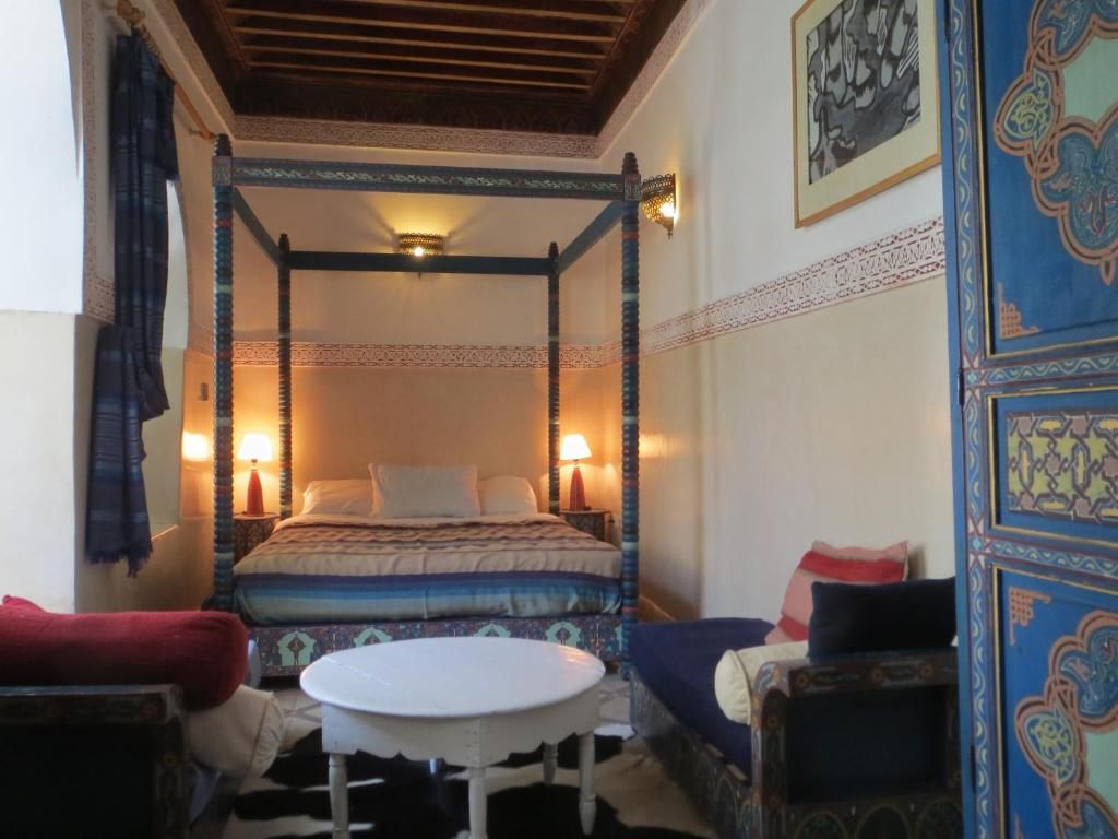 A bed or beds in a room at Riad Maizie