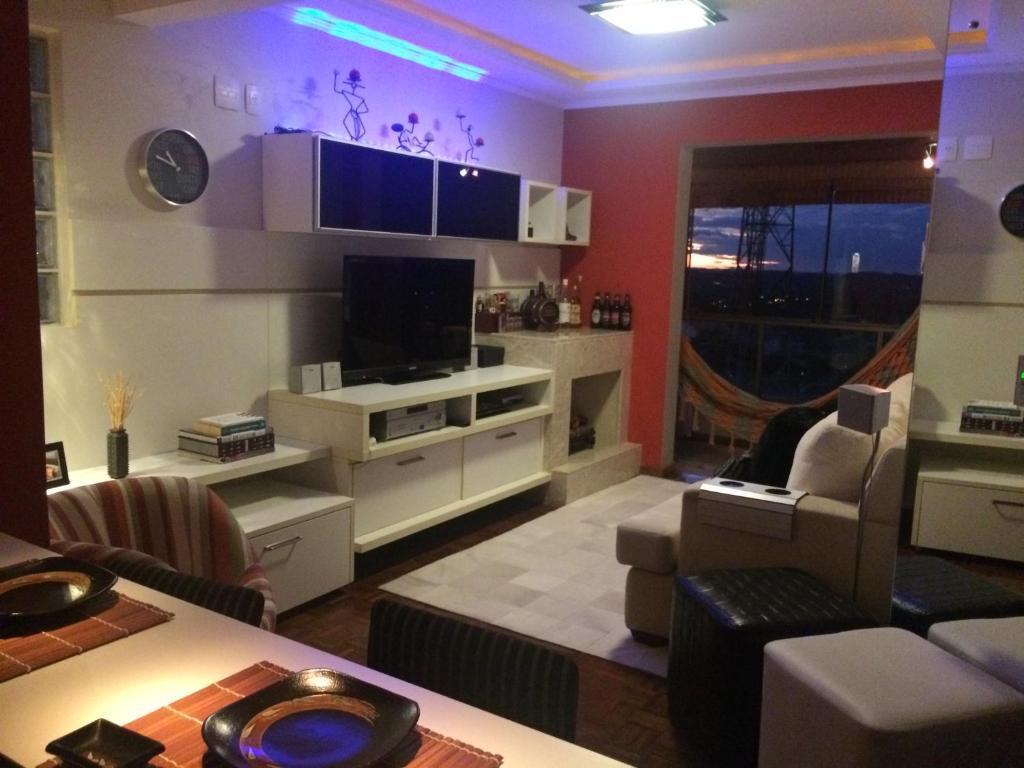 A seating area at Apartamento FLAT LUXO c/Lareira + Vista Vale dos Vinhedos