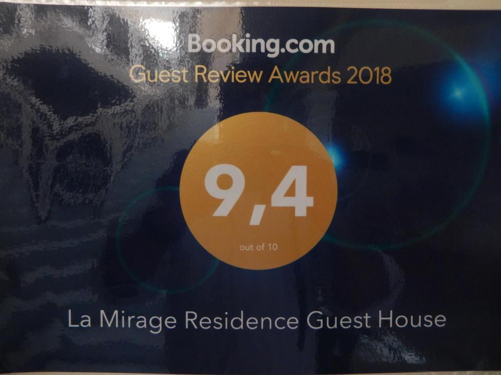 A certificate, award, sign, or other document on display at La Mirage Residence Guest house