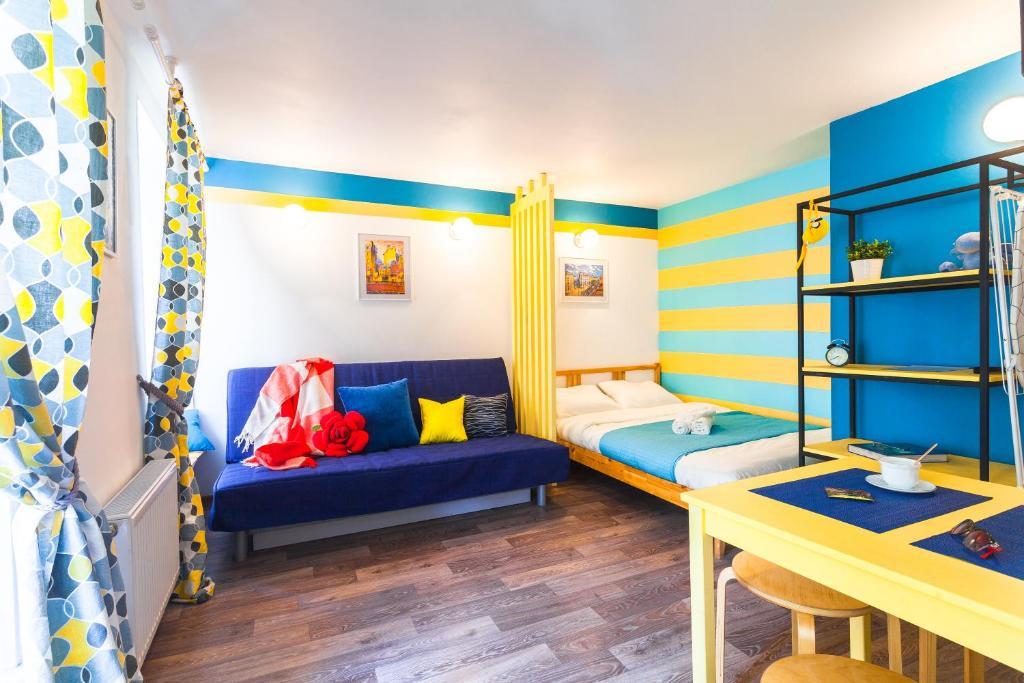 Двухъярусная кровать или двухъярусные кровати в номере MyWorld Apartments