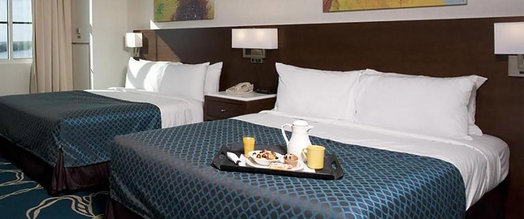 A bed or beds in a room at Tropicana Evansville