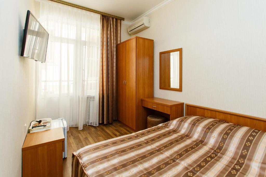 Кровать или кровати в номере СеАр