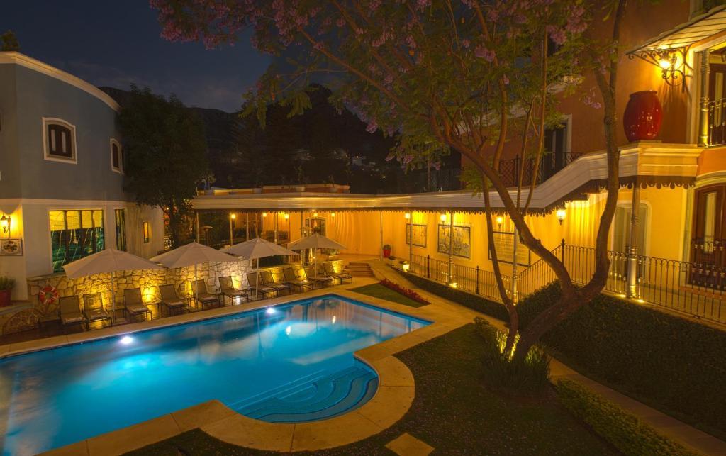 The swimming pool at or near Villa Maria Cristina Hotel