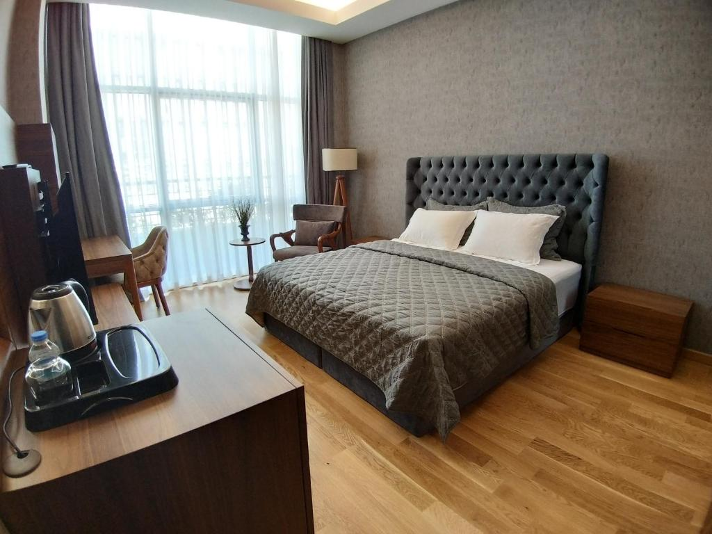 Кровать или кровати в номере Teknosports Otel