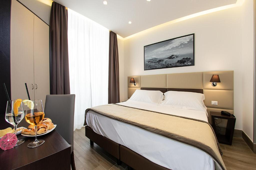 A bed or beds in a room at Palazzo Argenta; Sure Hotel Collection by Best Western