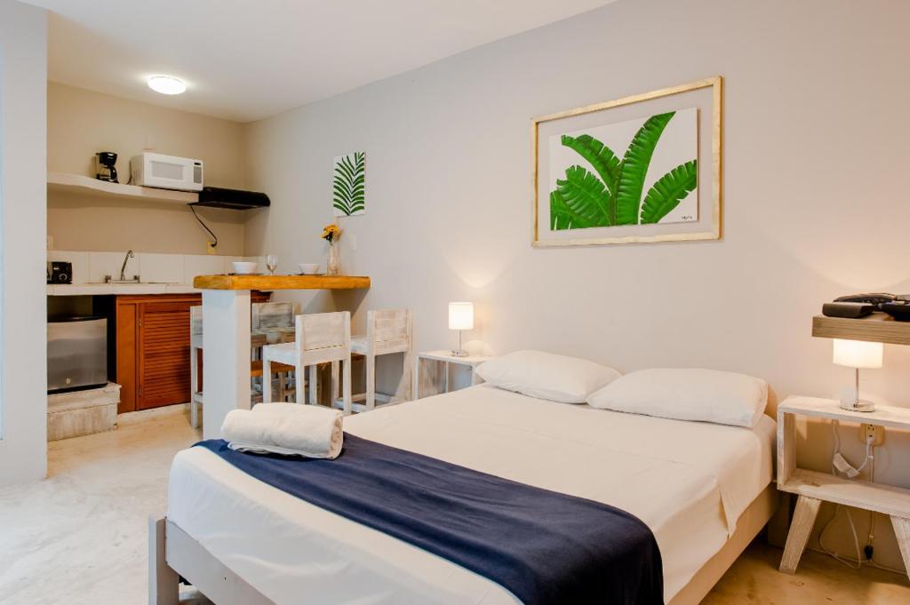 Cama o camas de una habitación en Rentalife Playa