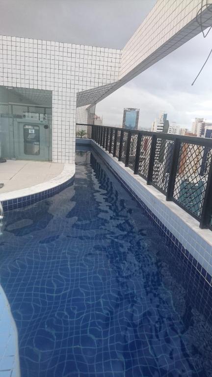 The swimming pool at or close to Apartamento Boa Viagem