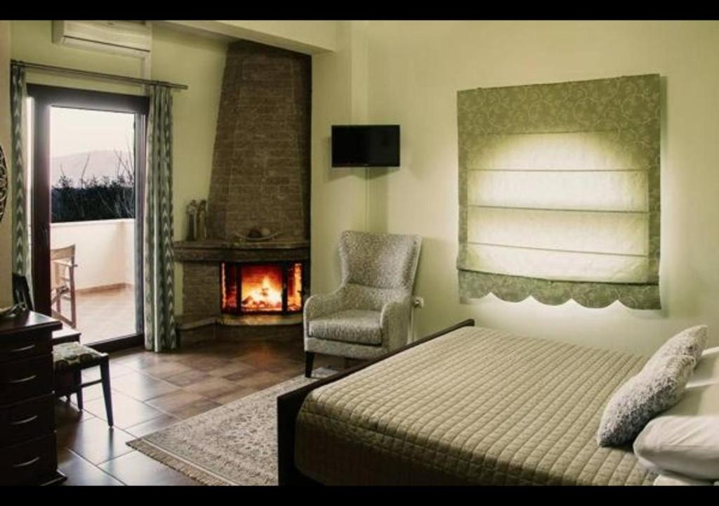 Ein Bett oder Betten in einem Zimmer der Unterkunft Gaia Kaimaktsalan