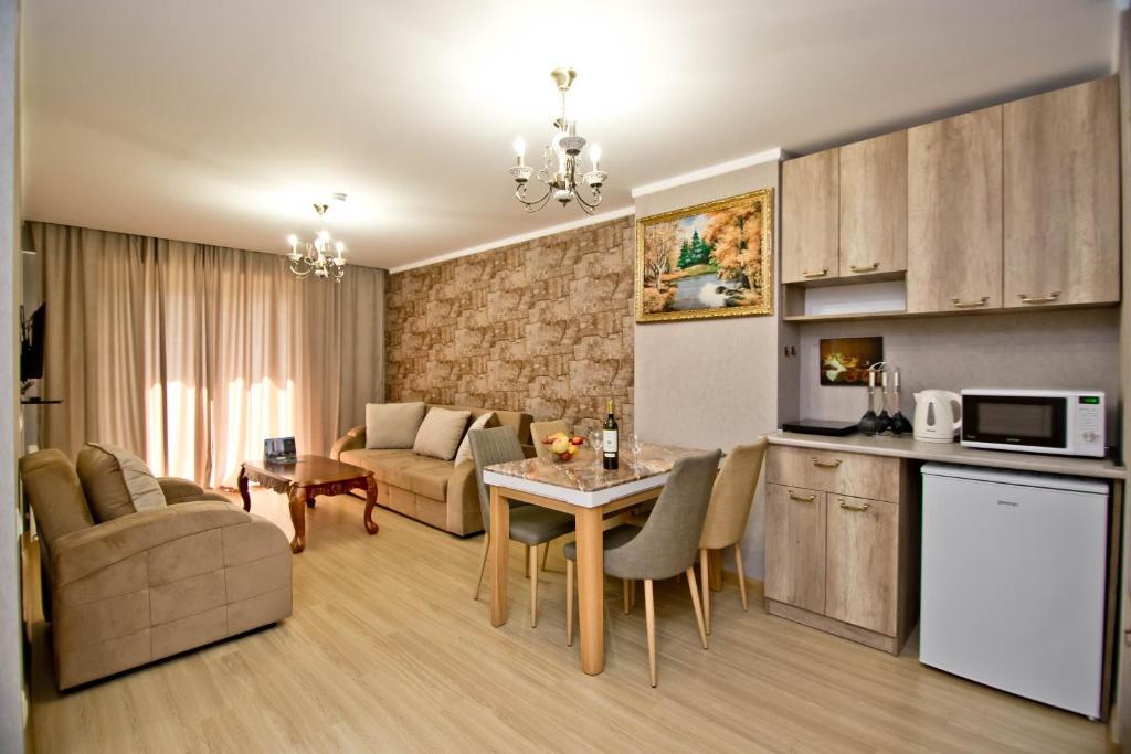 A kitchen or kitchenette at Orbi Bakuriani apartment 731