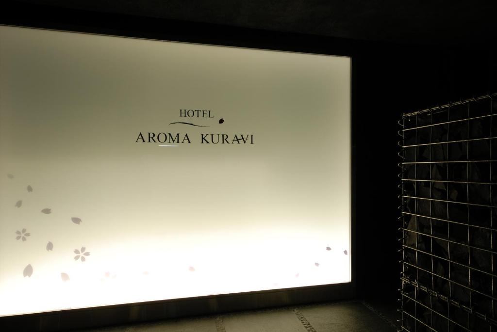 A television and/or entertainment centre at AROMA KURAVI (Adult Only)
