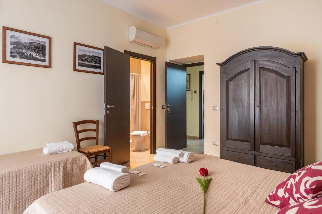 A bed or beds in a room at B&B Villamarì