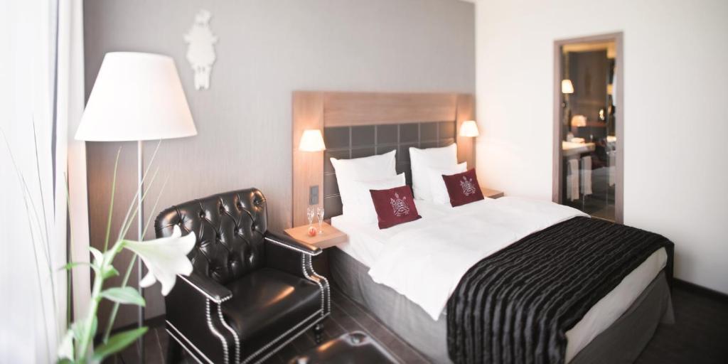 Ein Bett oder Betten in einem Zimmer der Unterkunft Mövenpick Hotel Stuttgart Airport