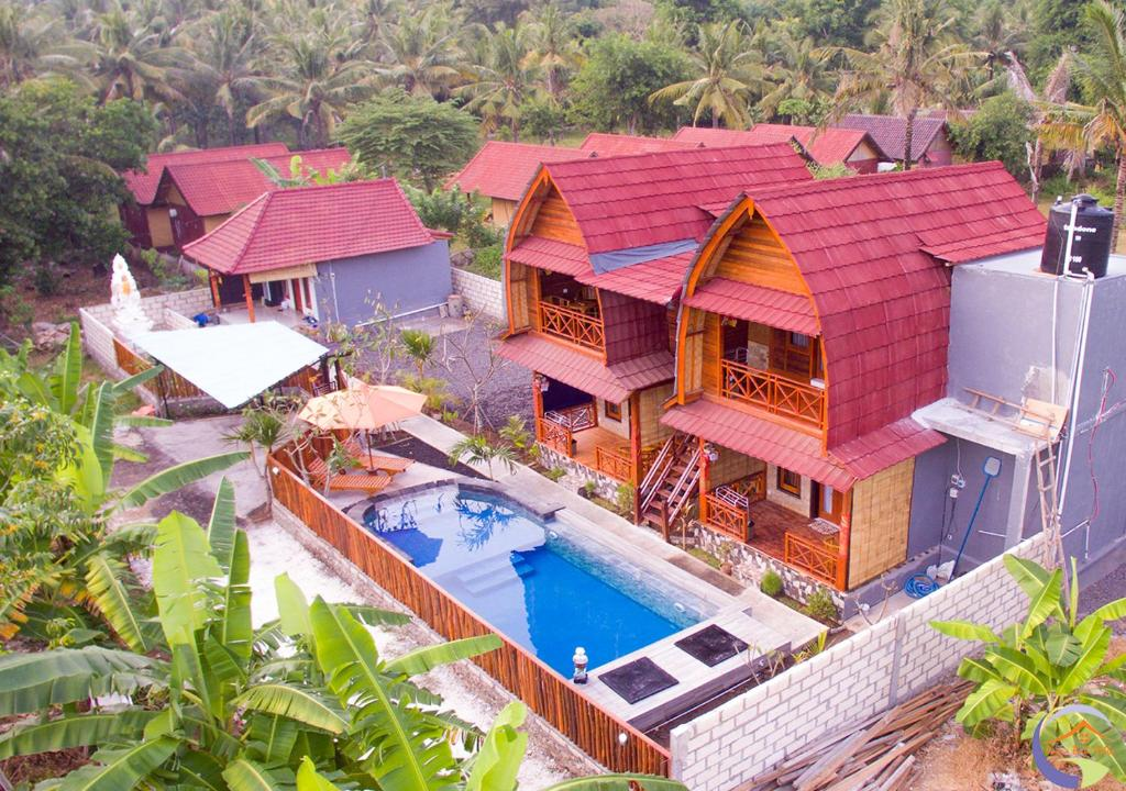 A view of the pool at Putra Bali Villa or nearby