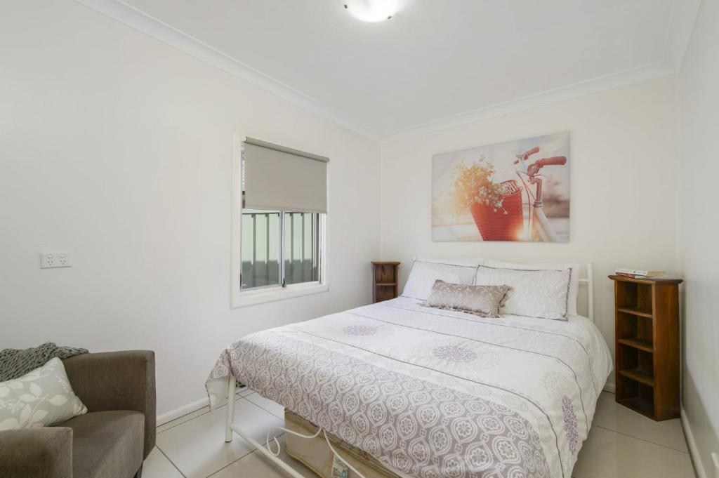A bed or beds in a room at 53 Hollingworth Street, Port Macquarie