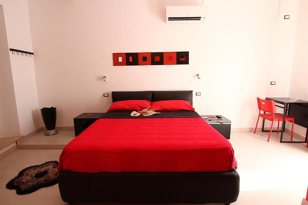 Letto o letti in una camera di Bedrooms Ninfa Del Lago