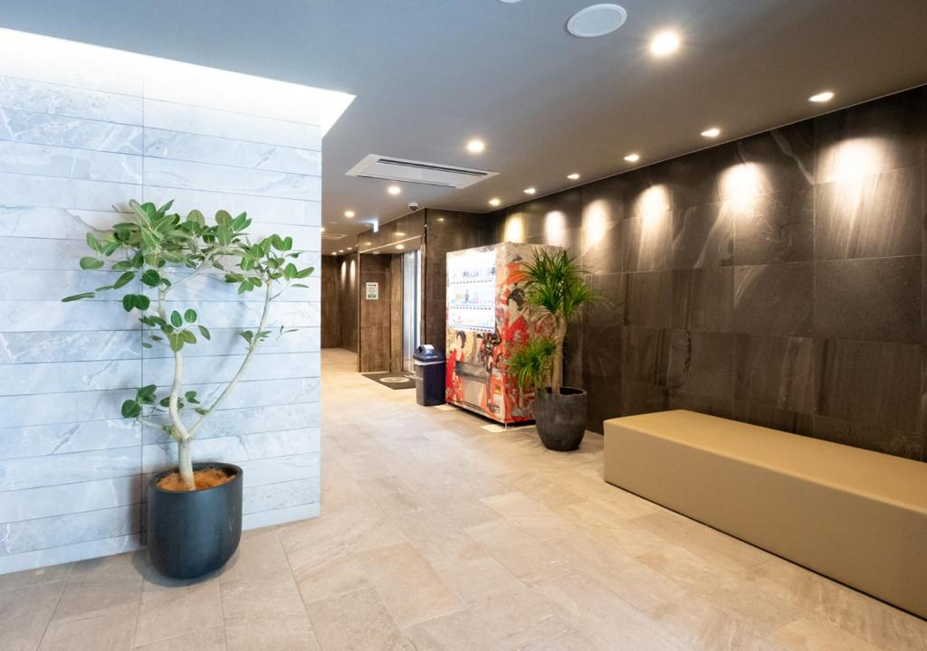 The lobby or reception area at Sonezaki Luxe Hotel