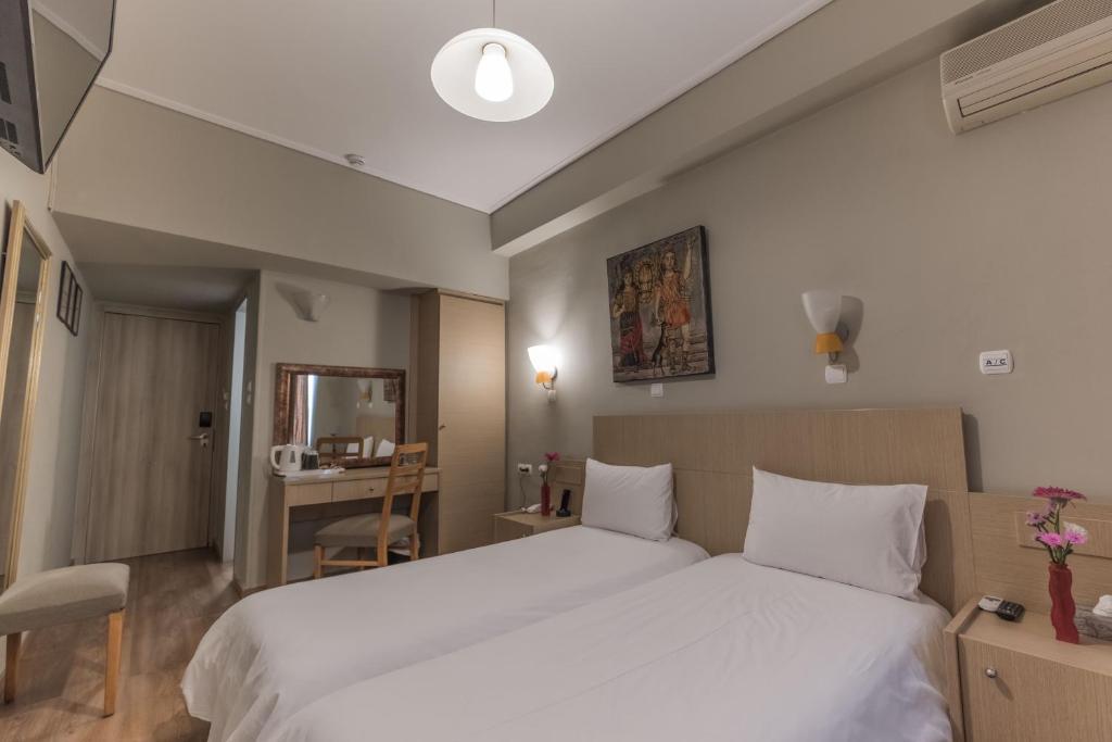 Кровать или кровати в номере My Athens Hotel