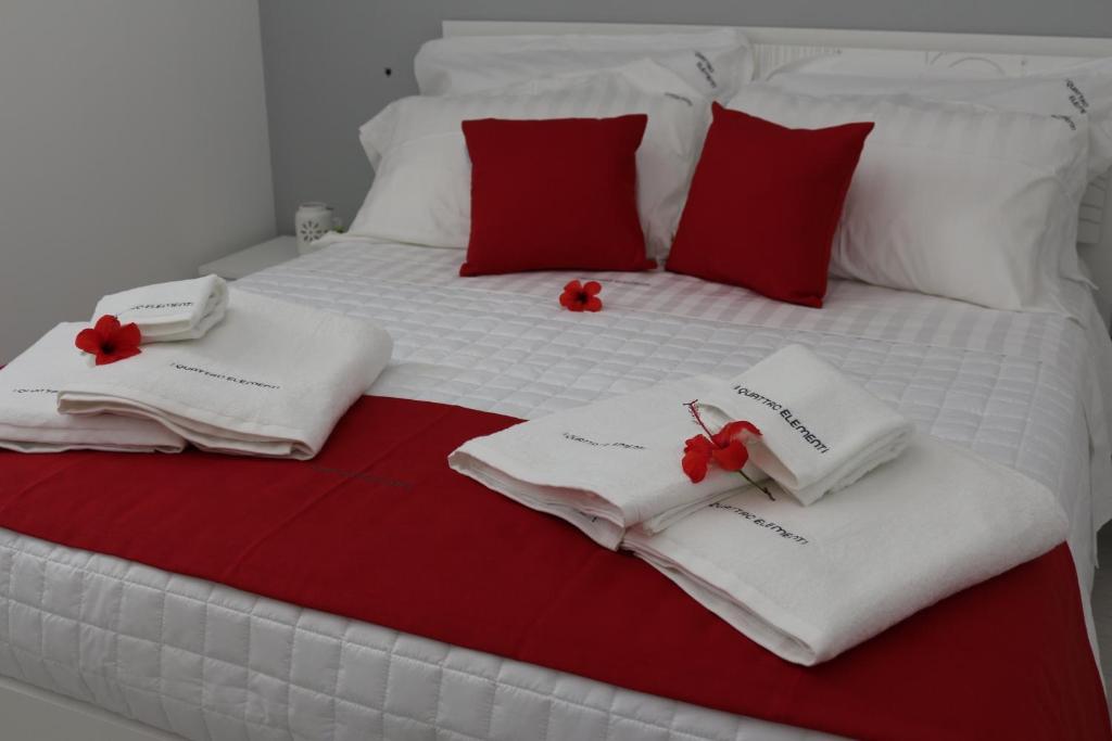 En eller flere senge i et værelse på I Quattro Elementi