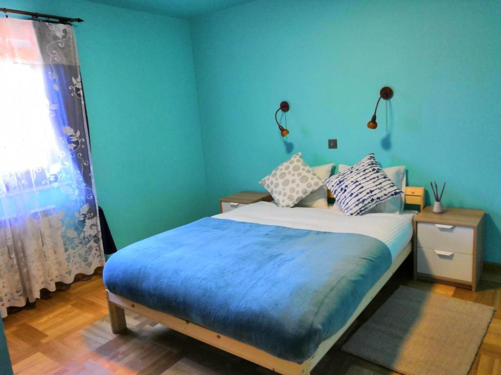 A bed or beds in a room at AVETHNA WARSAW AIRPORT HOSTEL