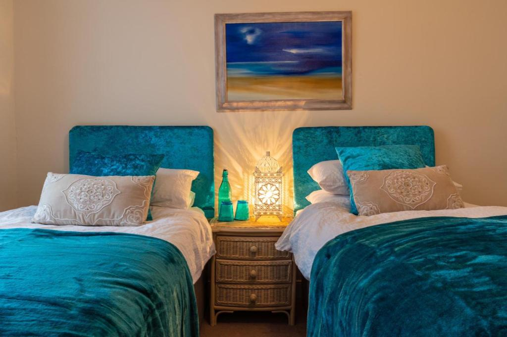A bed or beds in a room at Sacred Garden Retreat