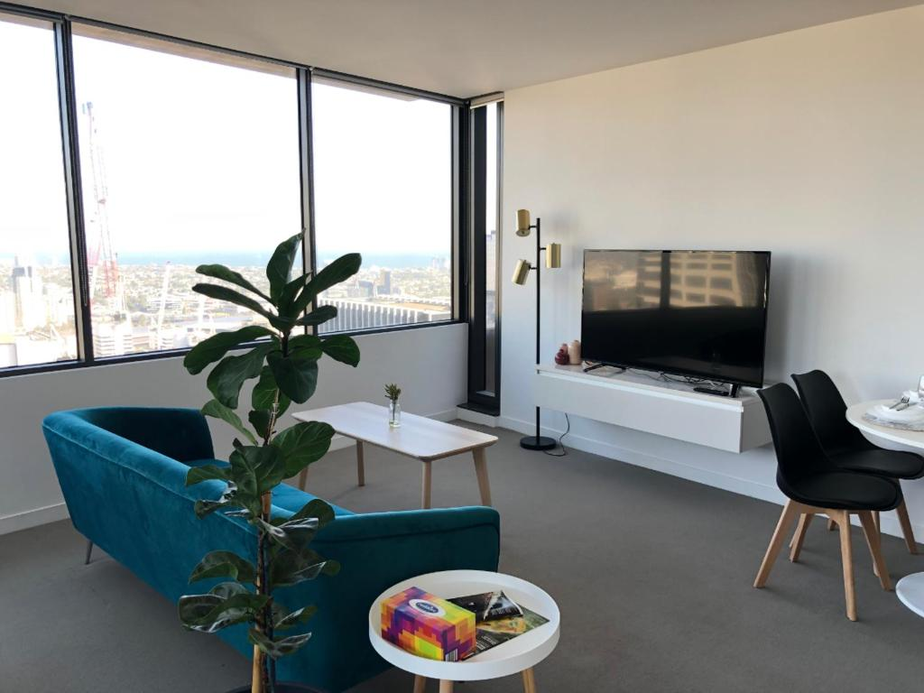 A television and/or entertainment center at Your Melbourne Home in Free Tram Zone with Great City Lifestyle